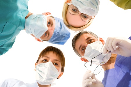 young successful medical team on the white . view from below. Stock Photo