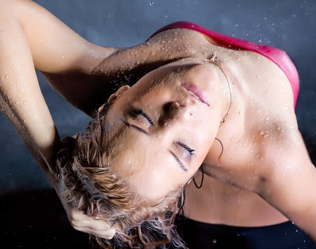 young expressive blonde woman enjoy in water splashes and droplets Stock Photo - 9802749