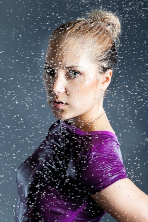 young expressive blonde woman in water  splashes and droplets on black background Stock Photo - 9802785