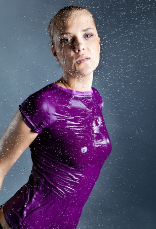 young expressive blonde woman in water splashes and droplets Stock Photo - 9802783