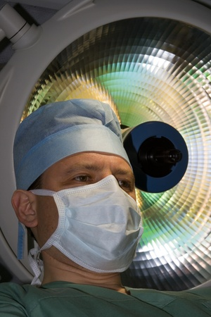 surgeon in OR under lamp Stock Photo - 10573690