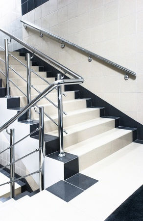 staircase with stair railing within building