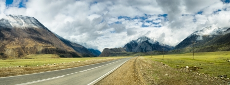 highway signs: long road in mountains. Altai. panoramic image from several pictures