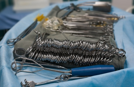 surgeon operating: surgical instruments in operation room