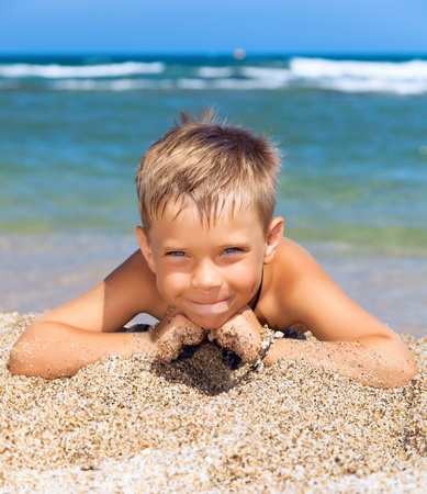 playful boy on the beach Stock Photo