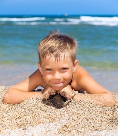 playful boy on the beach Stock Photo