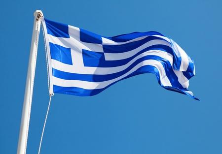 the greek flag: Greek Flag on Blue Background Stock Photo