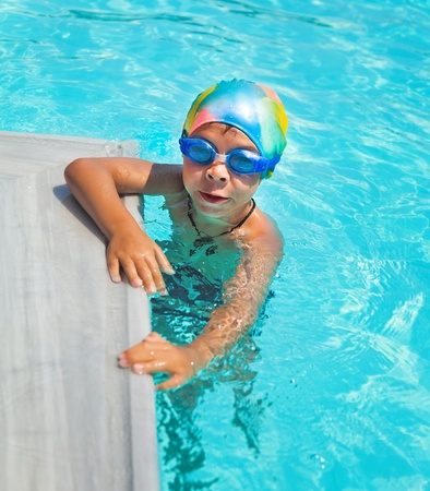 young boy in a swimming pool  photo