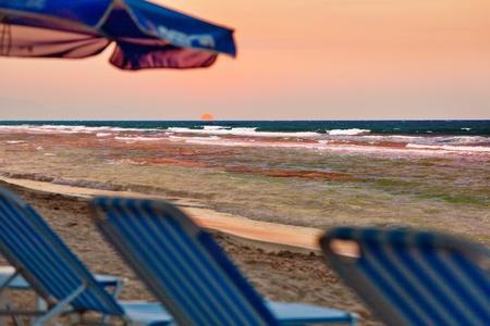 adirondack chair: Sunset Scene at Tropical Beach