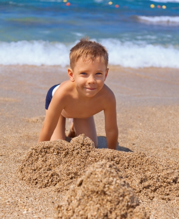 little boy: seven years old boy on the beach