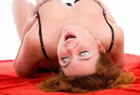young beauty sensual woman lying on red fabric Stock Photo - 14389477