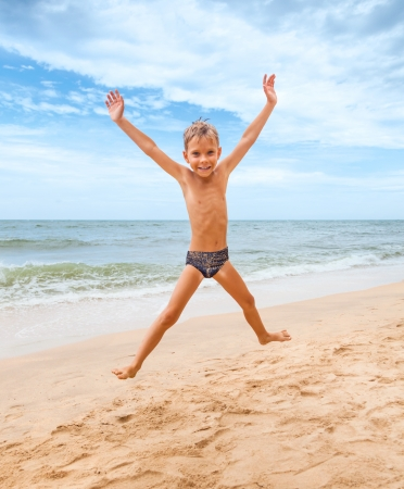 jumping boy on the beach with sea on background Stock Photo - 15072138