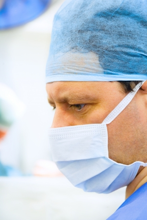 surgeon in operation room with lamp on background Stock Photo - 17850564