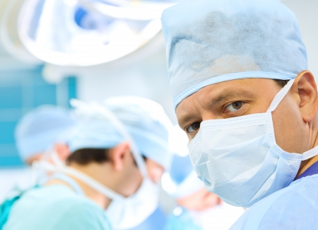 attentive look of surgeon in operation room