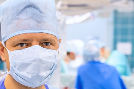 Attentive look of surgeon in operation room  photo
