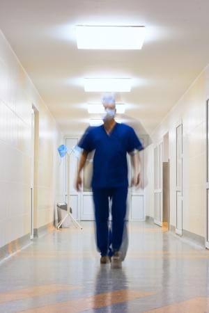 blurred in motion doctor in long corridor 免版税图像