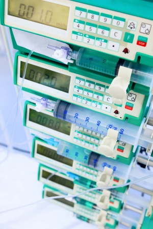 Syringe pumps in intensive care unit. Image with shallow DOF. 免版税图像
