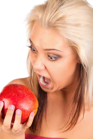 Young funny blonde woman with apple in hand  photo
