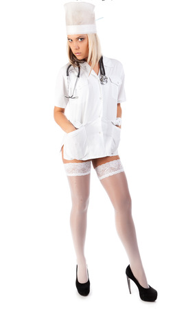 Young sexual female doctor with stethoscope isolated on white background photo