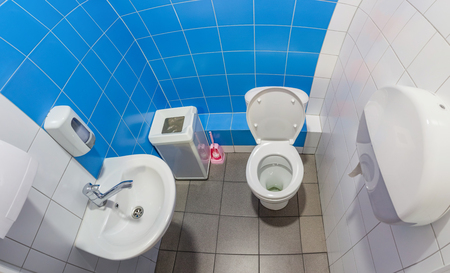 The public toilet with white bowl, washbasin and hand dryer. Picture from multiple images Stock Photo