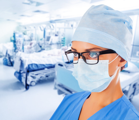 Young female doctor in intensive care unit.