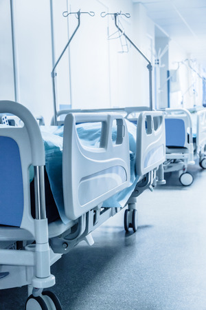 surgical: Long corridor in hospital with surgical beds. Tinted picture