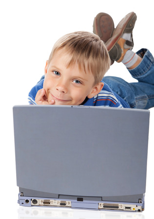five years old: Smiley Five Years Old Boy with Laptop Isolated on White Stock Photo