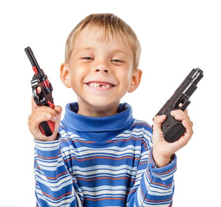 handgun: Playful Little Boy with Two Guns Stock Photo