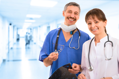 smiley medical team. three male and female doctors photo