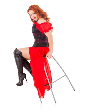 Elegant Retro Woman Wearing Red Gown and Boots on Chair photo