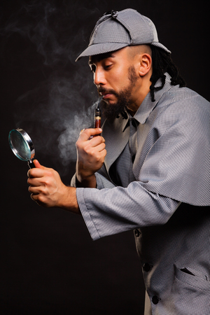 sherlock: Sherlock Holmes with pipe and magnifying glass on balck background Stock Photo