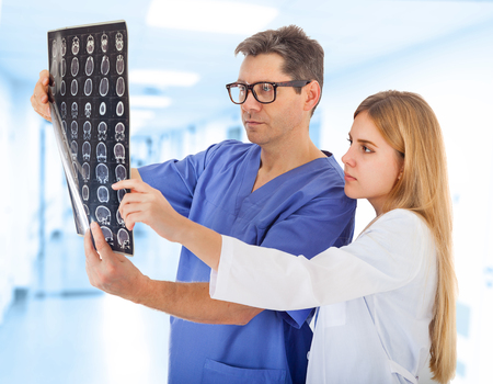 tomogram: Two Doctors in Clinics Corridor with X-ray Image Stock Photo