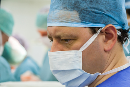 Look of male surgeon in operation room with his team Stock Photo