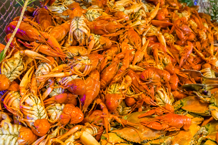 Boiled crawfish and crabs in a restaurant Stock Photo