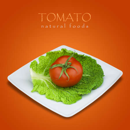 Tomato and savoy cabbage in plate on red background