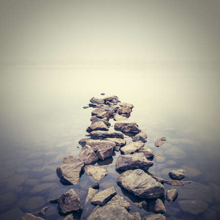 boulder rock: Minimalist misty landscape. Ukraine. Stock Photo