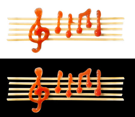 conceptual edible sheet music of noodles and ketchup photo