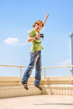 Crazy cheerful photographer in jump photo