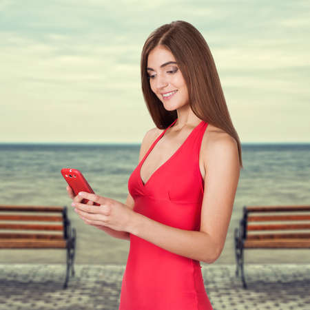 portrait of attractive young woman talking on the mobile phone isolated on white background