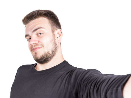 young man taking a selfie photo. Isolated on white background Stock Photo