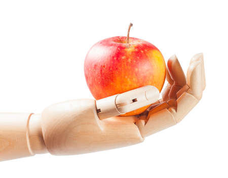 Wooden hand with apple isolated on a white background