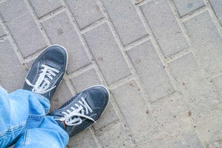 man feet on cobbled road Stock Photo