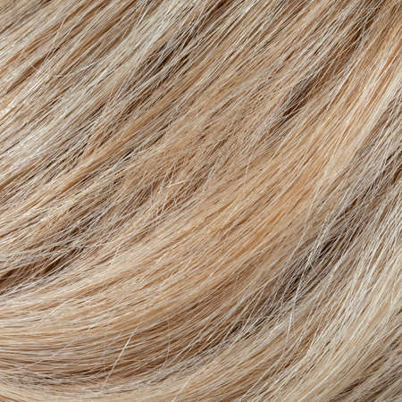 Wavy blonde woman hair background and texture Stock Photo