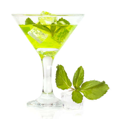 Glass of mojito cocktail with ice, isolated on white background
