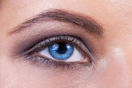 feminine beauty: Close up of a blue woman eye