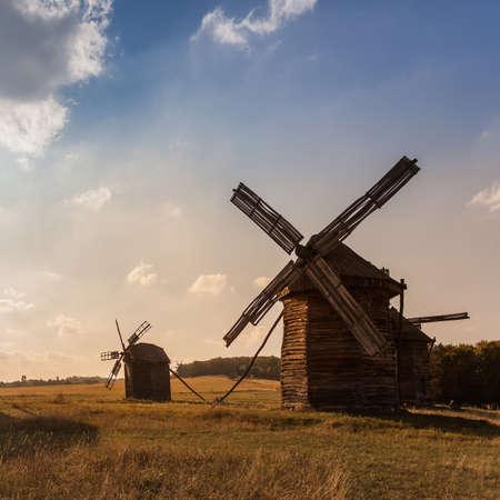 Traditional wooden ukrainian windmill in the field