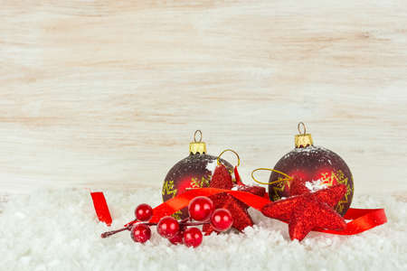Christmas balls and snowflake on wooden background Stock Photo