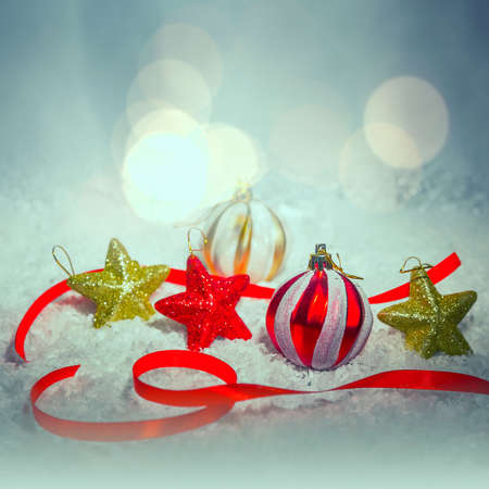 tonal: Christmas balls on snow background. Tonal photo filter correction. Stock Photo