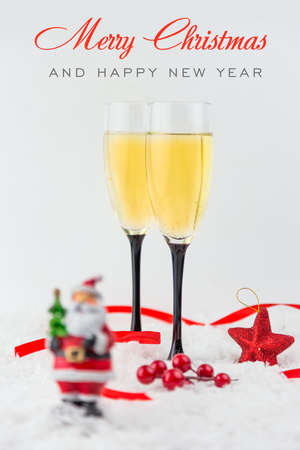Christmas tree toys, champagne and snowflake on white background