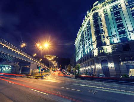 Car light trails and urban landscape. Moving car with blur light through city at night. Kiev city, Ukraine.